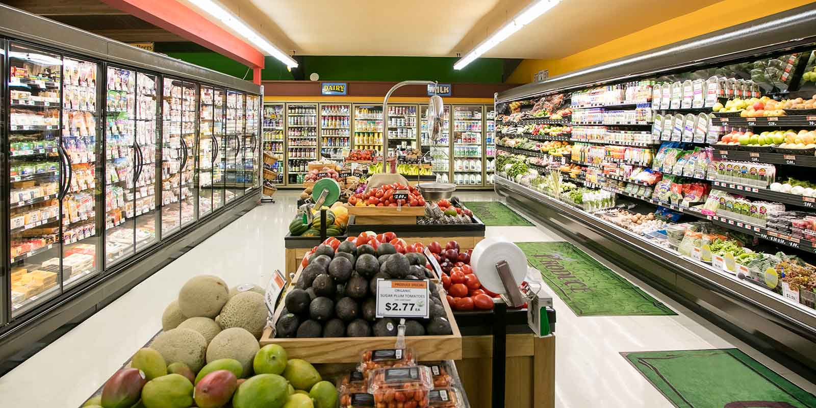 fresh aisle in grocery store featuring fruit and decor